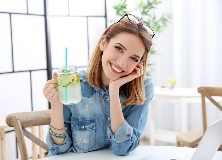 girl drinking fruit infused water