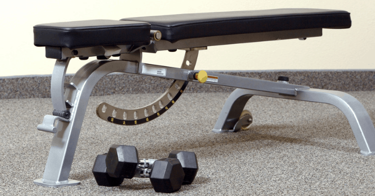 an adjustable weight bench at a home gym