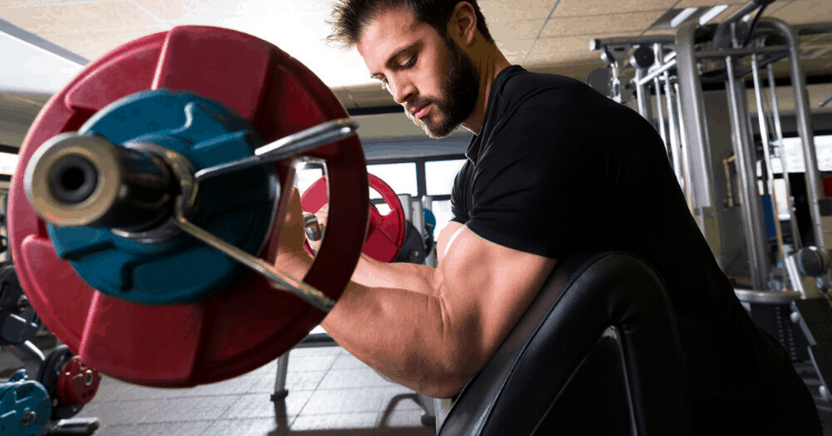 man doing preacher curls exercise