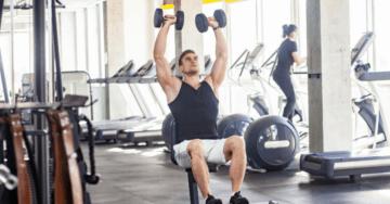 a man doing arnold press exercise