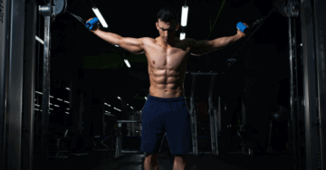 a man doing cable shoulder exercises